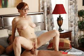 Pale Busty Hairy Redhead Penny Pax with Saggy Tits Wearing Skirt.
