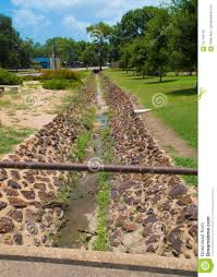 drainage ditch drainage ditch with a very rustic feel stock photo image of