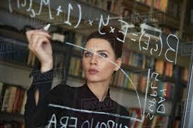 businesswoman writing formula on glass wall royalty free stock photo