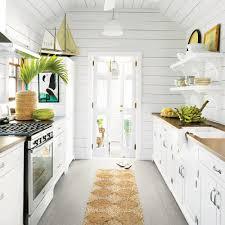 White kitchen Bar Stools The Daily Mail 10 Beautiful White Beach House Kitchens Coastal Living