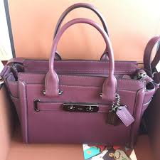 coach swagger 27 in glovetanned leather women s fashion bags wallets on carou