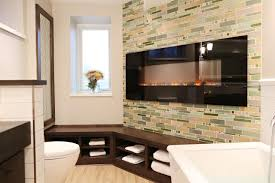 cozy master bathroom with custom tiled electric fireplace