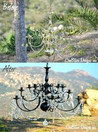 brass chandelier painted black tutorial brass chandelier transformed with black spray paint and crystals love this brass chandelier makeover black