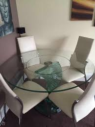 glass spiral dining table and coffee table set with 4 cream leather chairs