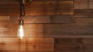 Pull Back As Vintage Modern Wood Wall Light Turns On Zooming Out From A Reclaimed Wood Wall To Reveal A Modern Vintage Light Turning On Stock Video