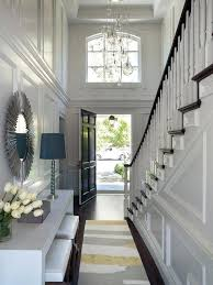 large chandeliers for foyers lighting for a tall foyer long two story foyer with yellow and gray rug transitional on large foyer chandelier lighting