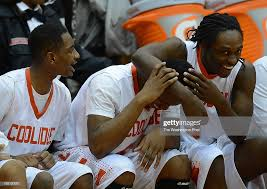 From left, Coolidge players Sam Briggs, Everett Coker, and ...