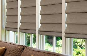 Brown Roman shades in a sunroom