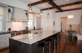 stylish metal pendant lights above kitchen island with marble countertop