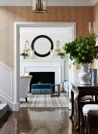 round black mirror over all white fireplace