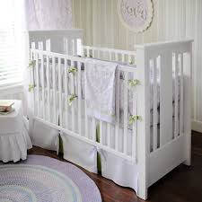 green and purple baby bedding