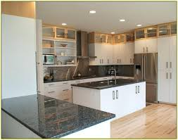 with dark awesome wood or black kitchen cabinets intended for pictures of kitchens with dark dark cherry cabinets with black granite countertops