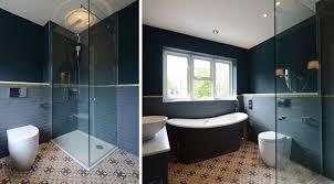 teal and dark indigo tiling with black bathtub