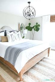 a coastal farmhouse style bedroom with striped rug orb chandelier navy blue and rugs cottage style rugs coastal