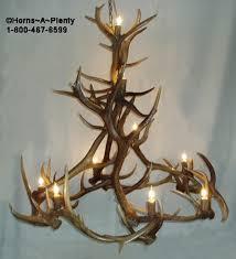 ant ek393 60 inch dia natural elk antler chandelier with 12 uplights by horns a plenty antler art shown with antler light socket covers