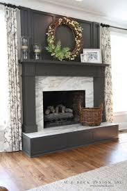 suzie m e beck design gorgeous charcoal gray painted fireplace with calcutta gold marble