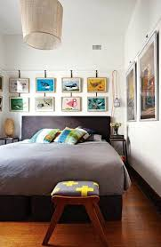art for bedroom. bedroom with beige palette hanging pictures along the wall in colorful and various models for art ideas