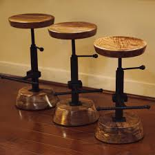 first woodworking project barstools made out of walnut and old tractor parts