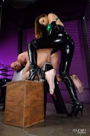Chanel Preston wears latex while enslaving Christian XXX with her.