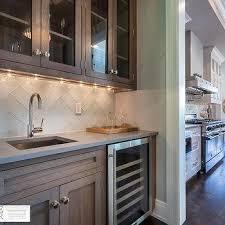 wet bar lighting. Wet Bar With Rift Sewn Oak Cabinets And White Glass Herringbone Tiles Lighting S