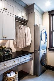 This traditional laundry room boasts a beautiful, updated design. Built-in  cabinets prevent