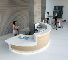 a curved look with wheel chair access under extended white top don t like colour etc but an idea not much working space behind desk