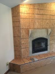 new fireplace insert framed in and ready to have faux stone applied