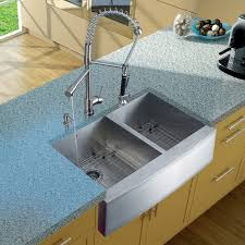 the vigo 33 in double bowl farmhouse stainless steel kitchen sink faucet two strainers and dispenser is constructed of solid brass with stainless steel