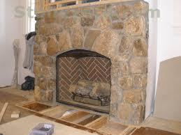 new england fieldstone round veneer fireplace br rockport construction