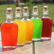skittles vodka in flasks on patio table