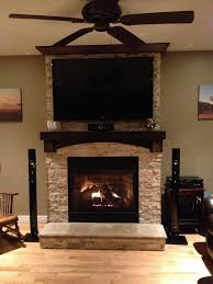 fireplace mantels with tv above stone on fireplace with tv mounted