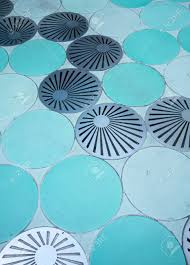 Drainage Channel Design Blue Circle Pattern Floor And Round Grate Drainage Channel Idea
