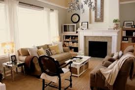 gray walls with a very tan sofa and chairs she even has paint above the gray paint living room18 tan