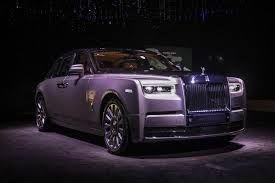 rolls royce phantom white interior. the new rollsroyce phantom viii manufactured by motor cars ltd stands on display during a media preview of its unveiling in london rolls royce white interior