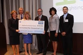 ge foundation presents donation to neighborhood family practice