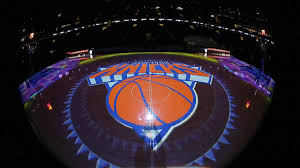 Knicks in orange and blue above orange basketball on grey triangle. Leon Rose Led Knicks Will Be Rewarded For Rare Patience In Rebuilding Effort Cbssports Com