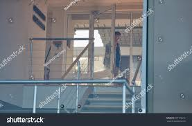 walking through front door. Image Of A Young Broker Walking Through The Glass Front Door His Luxurious Modern Penthouse L