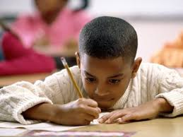 writing strategies for students adhd edutopia boy in deep concentration writing pencil
