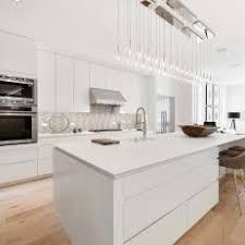 White kitchen dark wood floor Tiled White Modern Kitchen With Oak Floors Photos Hgtv Photos Hgtv