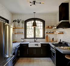 highlights includes a viking range and hood elongated subway tile with black grout