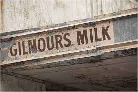 hand painted sign on a former milk bar in australia