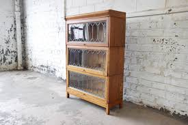 antique tiger oak three stack barrister bookcase with leaded glass doors at 1stdibs
