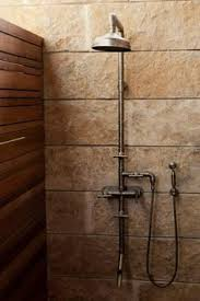 exterior shower fixtures. a rugged exposed-thermostatic shower set; lake|flato architects exterior fixtures i