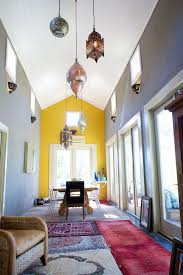 Yellow accent wall. See More. A) Layer smaller rugs to create a nice look  that covers up ugly floors?