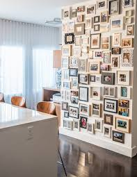 large collage frames hall contemporary with dark stained wood floor dark stained wood floor photo collage wall