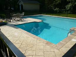 concrete pool coping | Stamped custom pool deck with brick coping