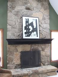 fireplaces black distressed mantle on stone