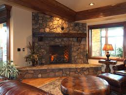 corner wooden fireplace mantel with stone