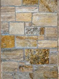 with all of the granite countertops out there and the trendy small scale tile standing before a substancial stone wall or structure reminds me of the