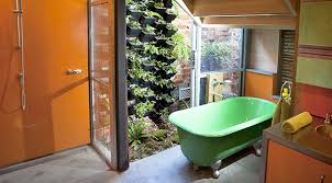 the bathroom walls feature locally produced recycled plastic a green wall planter and old